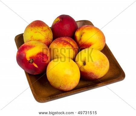 Nectarines In Wooden Plate