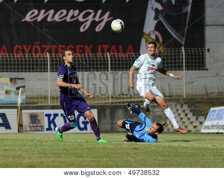 KAPOSVAR, HUNGARY - AUGUST 3: Viktor Nemeth (in blue) in action at a Hungarian National Championship soccer game - Kaposvar (white) vs Kecskemet (purple) on August 3, 2013 in Kaposvar, Hungary.