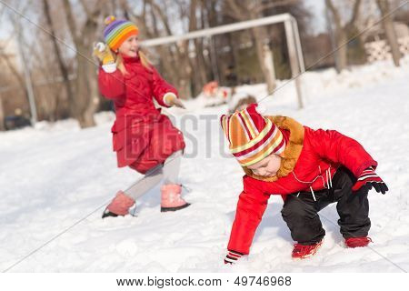 Children in Winter Park playing with snowballs