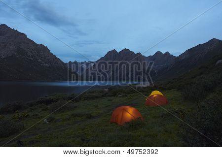 Lit Tents On Lakeshore