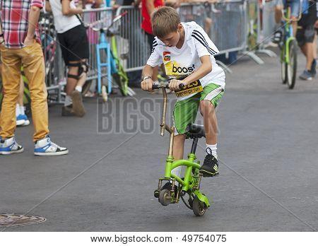 Kid On Strange Bicycle