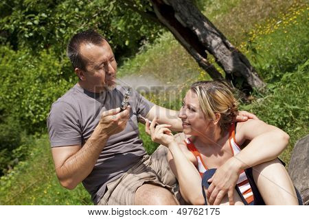 Couple With E-cigarettes Outdoor