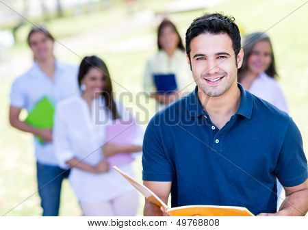 Male student  at the university campus looking very happy