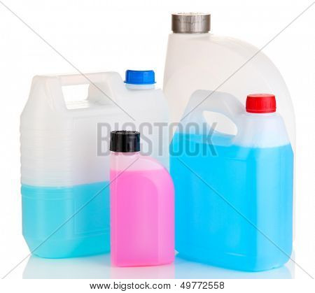 Different liquids for car in canisters isolated on white