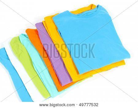 Neatly folded shirts isolated on white