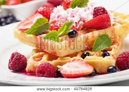 Waffle cake with fresh berry fruit and whipped cream