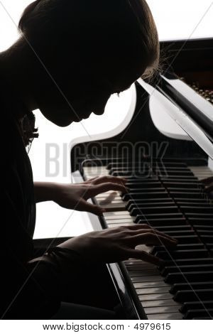 Beautiful Girl Playing The Piano