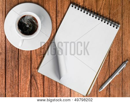 Sketch Book Silver Pen And White Cup Of Hot Coffee