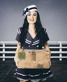 Beautiful Sailor Girl Holding Military Ammo Box