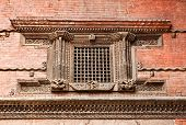 stock photo of hanuman  - Carved wooden window on Hanuman Dhoka old Royal Palace Durbar Square in Kathmandu - JPG