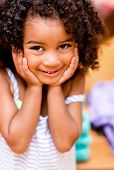 stock photo of shy girl  - Portrait of a sweet little girl looking shy and smiling - JPG