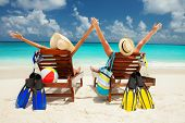stock photo of beach hat  - Happy couple on the beach of sea - JPG