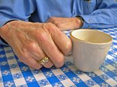 picture of coffee-cup  - elderly man holding coffee cup - JPG