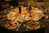pic of wedding table decor  - Wedding Table setting with rusted colors and orange decorations - JPG