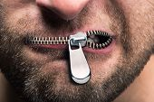 stock photo of emotions faces  - Insubordinate man with zipped mouth - JPG