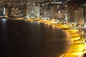 stock photo of all-inclusive  - Huge bay of hotels stretching along the coast in Acapulco Mexico