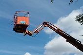 foto of boom-truck  - Crane with hydraulic boom lifted up sky background - JPG