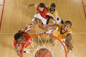 stock photo of slam  - High angle view of basketball player dunking basketball in hoop - JPG