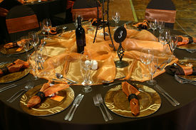 stock photo of wedding table decor  - Wedding Table setting with rusted colors and orange decorations - JPG
