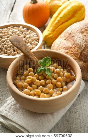 chickpeas soup on wood bowl
