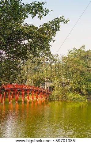 HANOI, VIETNAM, JANUARY 13, 2013 - Huc Bridge on Hoan Kiem Lake. The lake is one of the major scenic spots in the city.