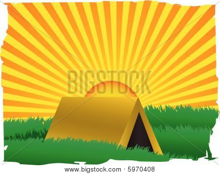 Glowing sun rise over tent inside grassy field