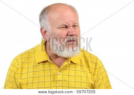 disgusted displeased senior bald man in yellow shirt