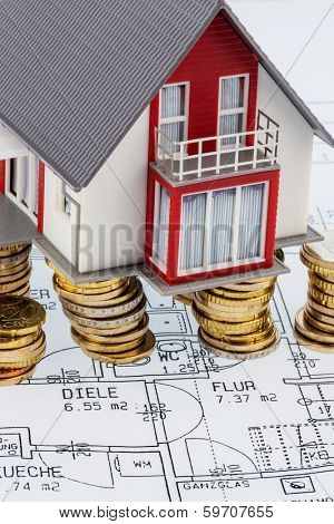 residential house on blueprint symbol photo for house construction, financing, building society