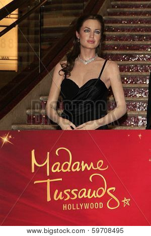 LOS ANGELES - FEB 13: Angelina Jolie, wax figure at the unveiling of a new Sandra Bullock wax figure by Madame Tussauds at Hollywood & Highland on February 13, 2014 in Los Angeles, CA.