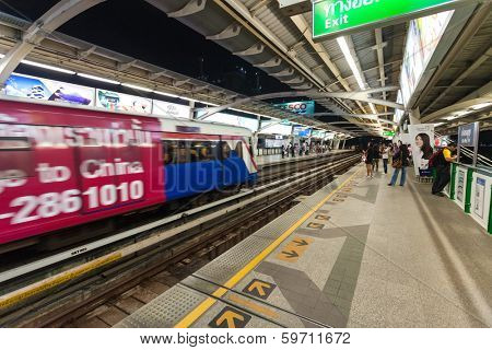 BANGKOK, THAILAND - JANUARY 10, 2012: People at  BTS Skytrain waiting for train. 600,000 passengers ride the Skytrain daily.