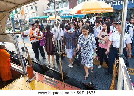 BANGKOK, THAILAND - JANUARY 10, 2012: Tourists entering the Khlong Saen Saep water bus. It serves over 50,000 passengers daily.