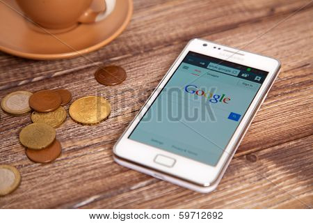 WROCLAW, POLAND - JANUARY 10, 2014: Photo of Samsung Galaxy S II device with google.com homepage on its screen