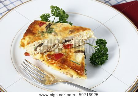 Slices of Spanish omelette on a plate with a fork.
