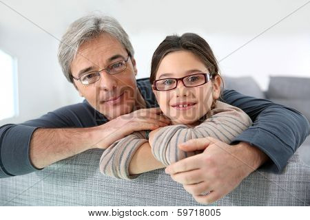 Portrait of man with his 8-year-old daughter