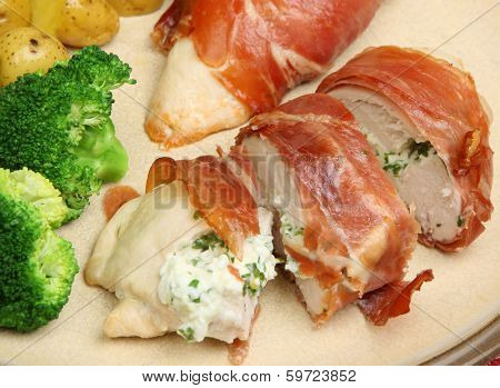 Chicken breast stuffed with cottage cheese and herbs and wrapped in pancetta.