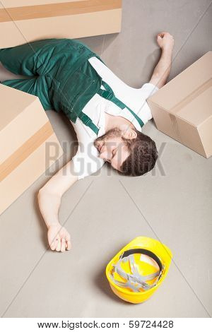 Wounded Warehouse Worker Lying On The Floor