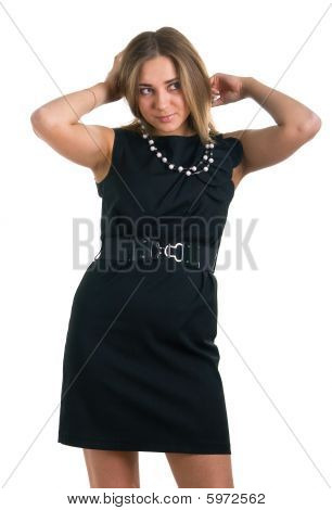 Woman In A Black Dress Holds In Hands A Beads