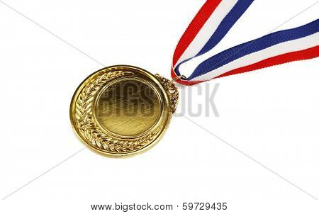 Closeup of golden medal on plain background