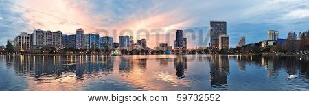 Orlando downtown Lake Eola panorama with urban buildings and reflection