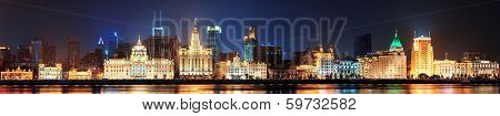 Shanghai historic architecture panorama at night lit by lights over Huangpu River
