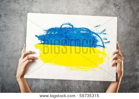 Man Holding Banner With Ukrainian Flag.