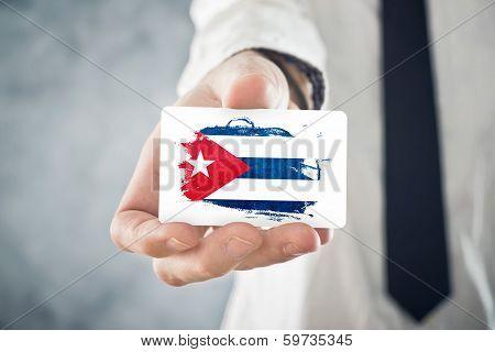 Cuban Businessman Holding Business Card With Cuba Flag