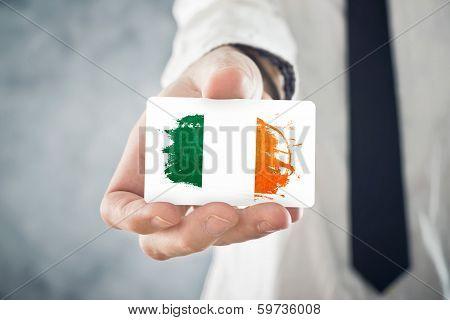 Irish Businessman Holding Business Card With Ireland Flag