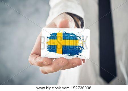 Swedish Businessman Holding Business Card With Sweden Flag