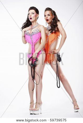 Two Funny Surprised Women In Stagy Costumes With Headphones