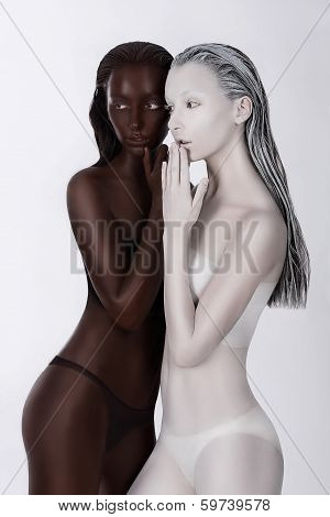 Ethnicity. Fantasy. Futuristic Women Painted White And Black. Art Bodypainting