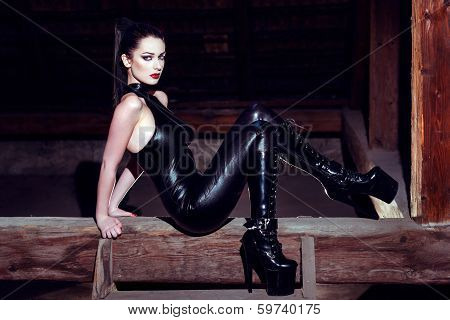 Beautiful Fetish Model Posing On Timber In High Heel Platform Boots