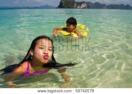 Two Girls Swimming In The Water At The Beach Of The Koh Ngai Island Thailand