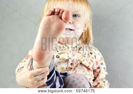 Little Girl Shows Her Barefoot