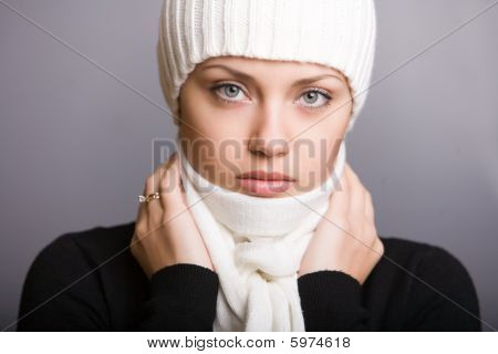 Thoughtful Young Woman In Scarf And Cap